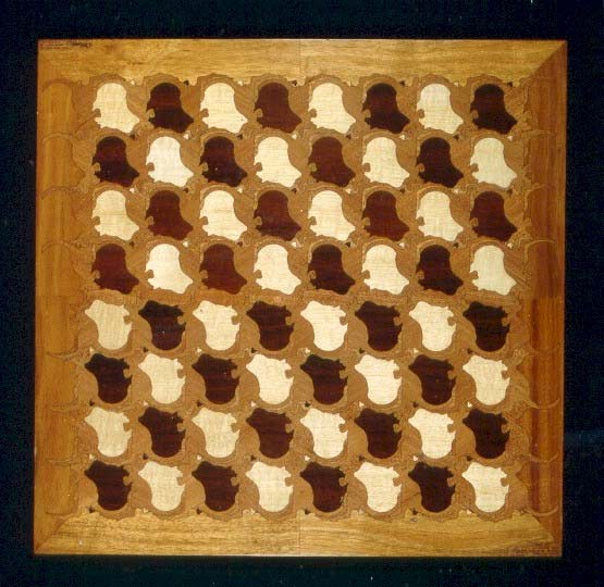 chessboard: a kangaroo and australian continent tessellation carved from thin plywood by a laser
