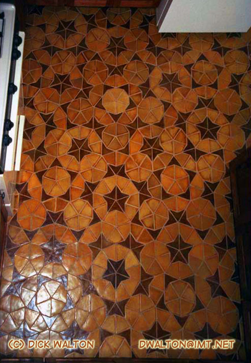 penrose tessellation: symmetric tiling pattern of ceramic tiles