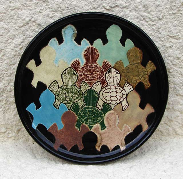 Escher-style tessellation symmetric pattern of turtles on a dinner plate